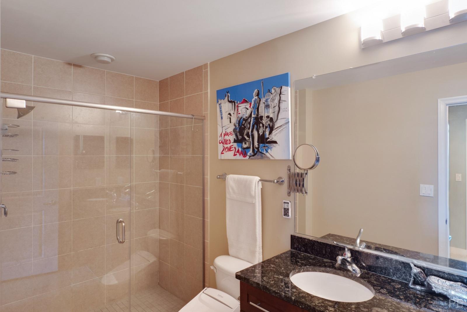 Master bathroom shower with a frameless glass door